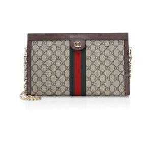Gucci canvas clutch leather trim, 100% authentic.